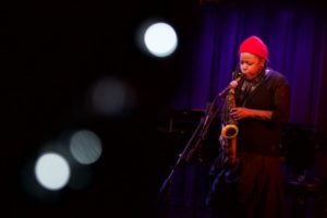black female saxofon player at the stage