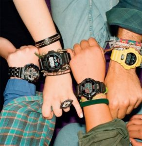 young people's hands with watches